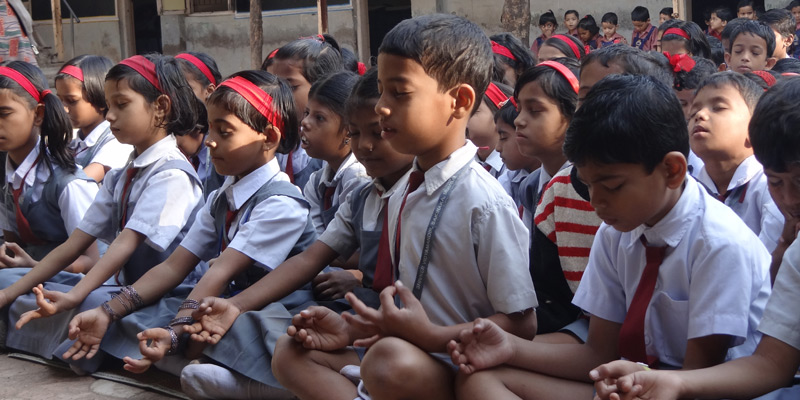 Kids doing meditation with Santosh Joshi